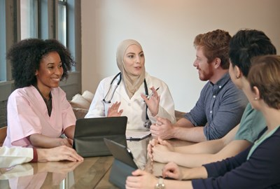 diverse group of nurses at a meeting
