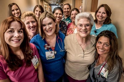 Happy group of smiling real nurses in Anne Arundel Medical Center hospital hallway