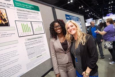 two nurses with their poster at exhibit hall at 2018 ANCC Magnet Conference
