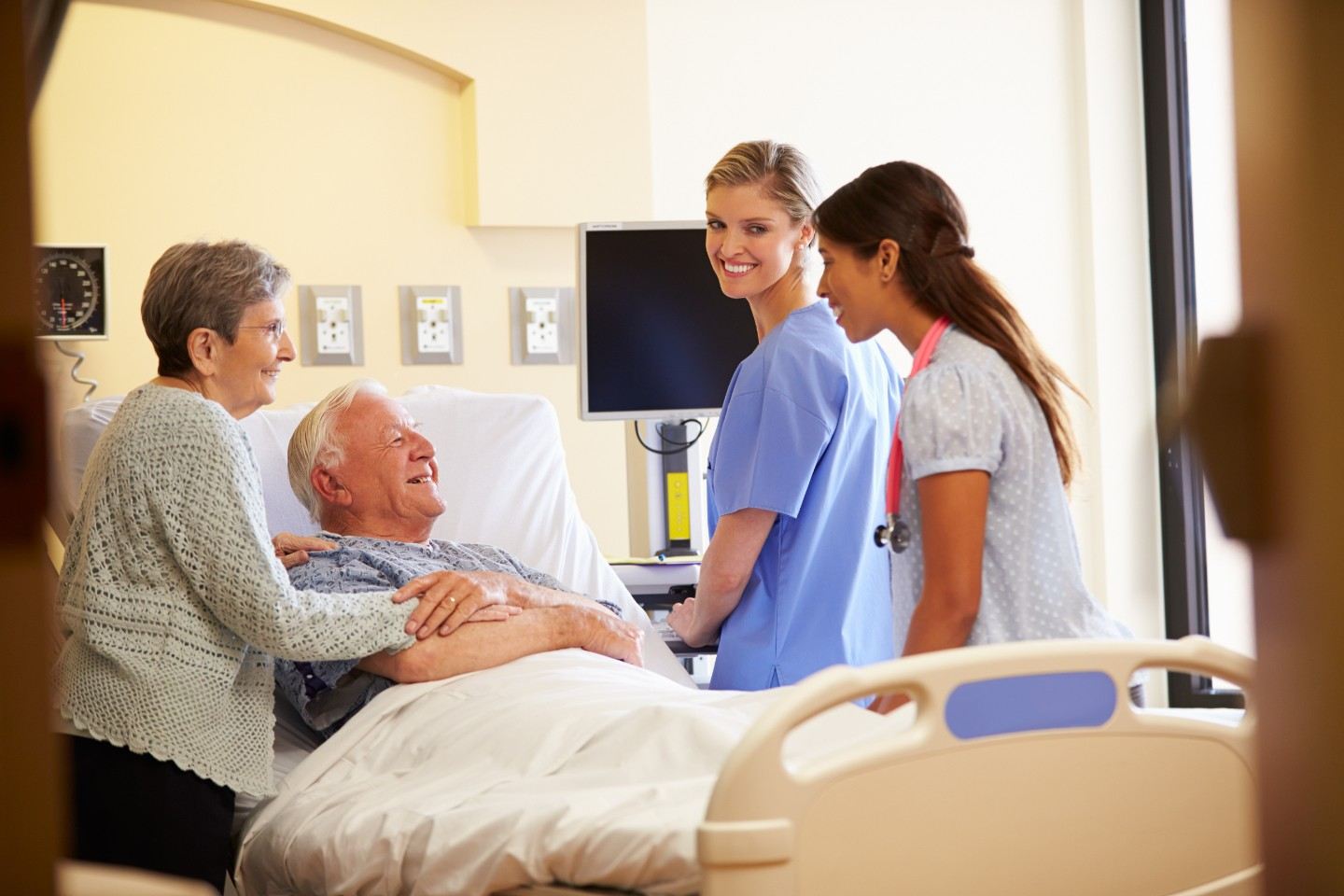 nurse with patient and family
